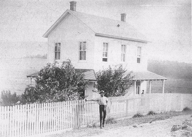 Daniel F. Guers in front of the farm house